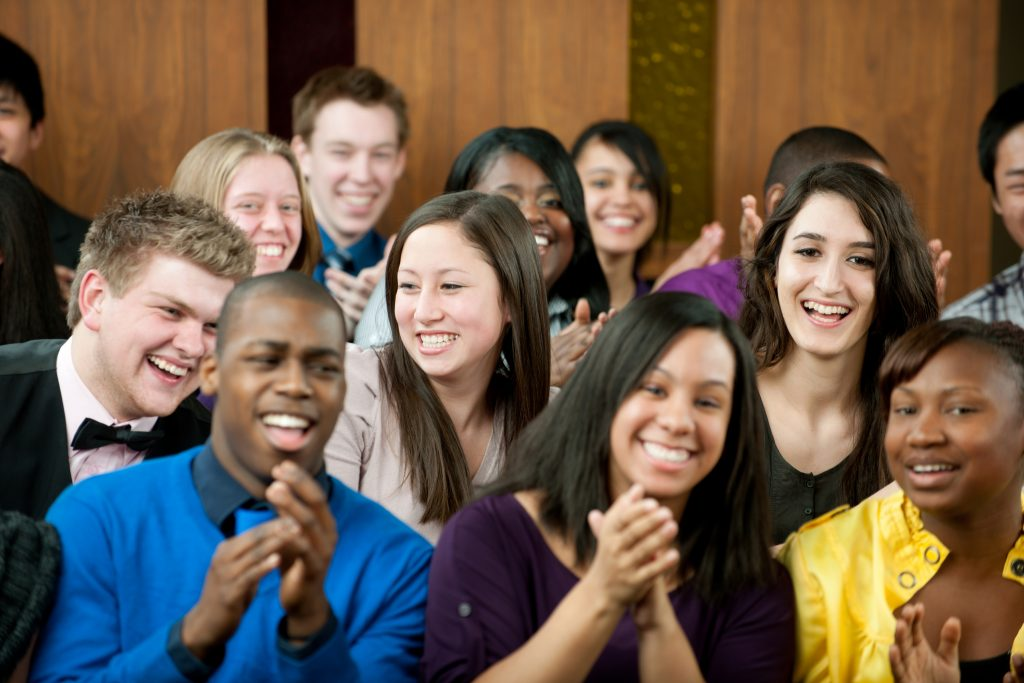 A diverse group of young adults at church.